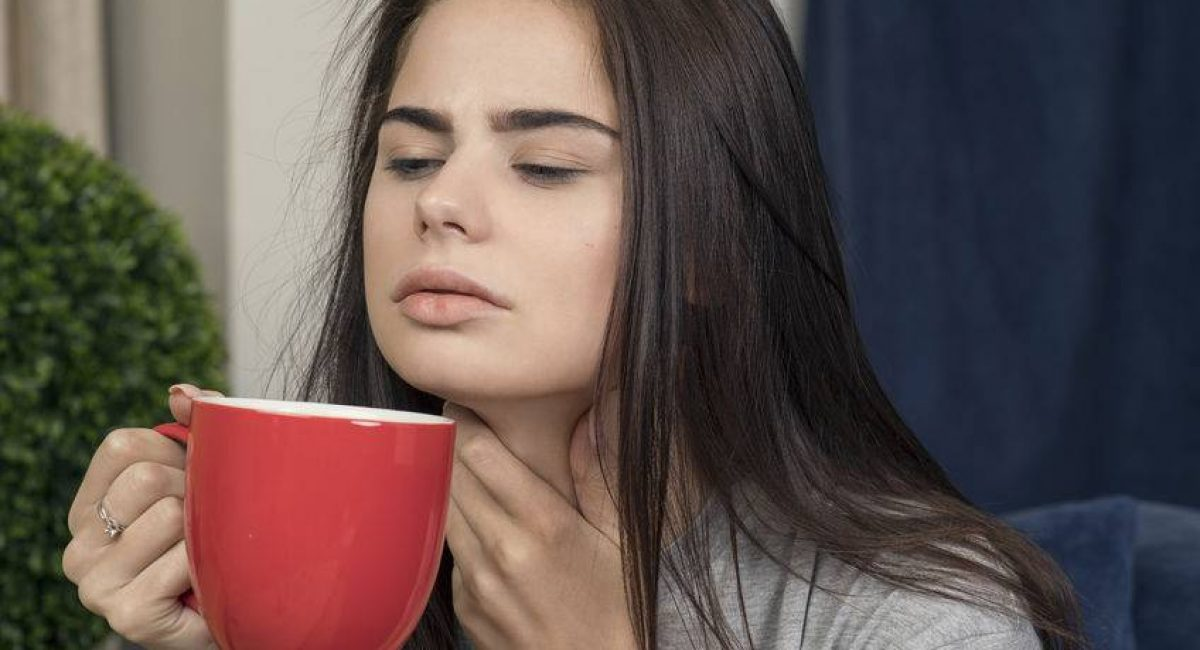 58903876 - young woman with a sore throat drinking tea
