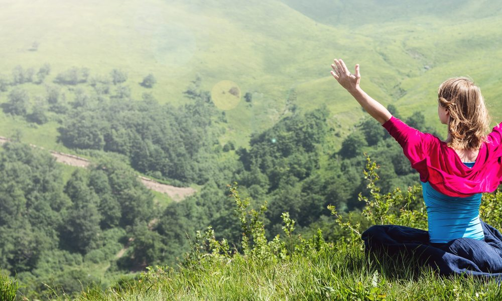 Blonde Woman Doing Yoga at the Mountains